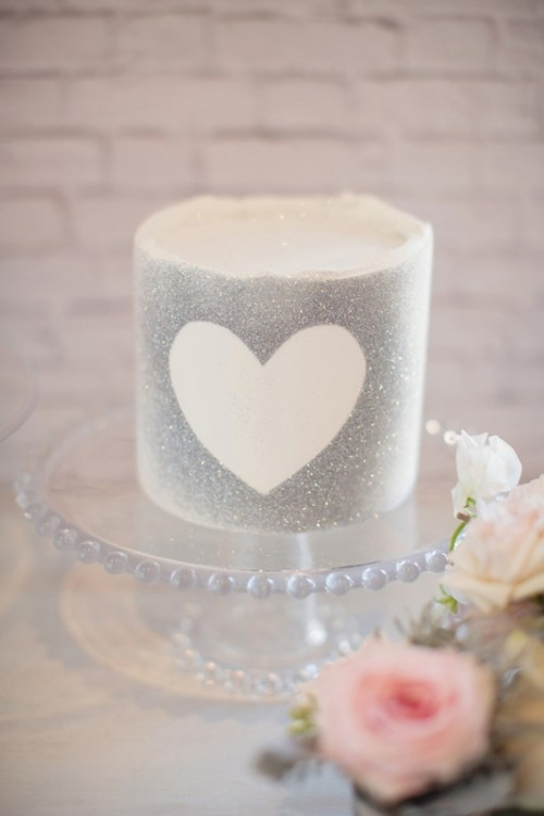 a silver grey wedding cake with a heart is a cool glam dessert for your wedding
