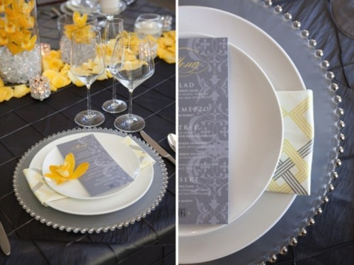 a refined graphite grey and bold yellow wedding tablescape with a petal garland and grey stationery