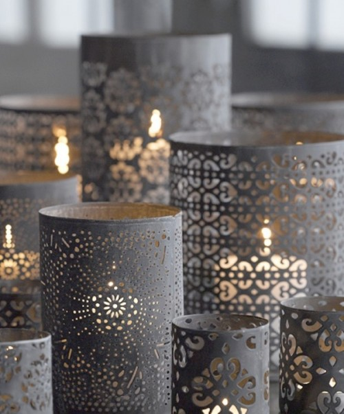 grey laser cut candleholders are great for creating a mood and an ambience