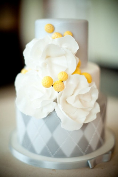 a grey wedding cake with a geometric tier and white sugar blooms is a cool idea rock for your wedding