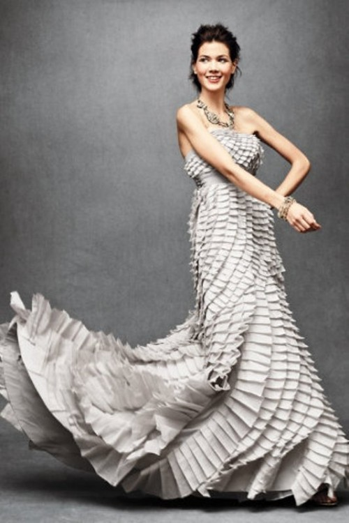 a strapless layered A-line wedding dress in grey fully covered with ruffle tiers for a non-traditional bride