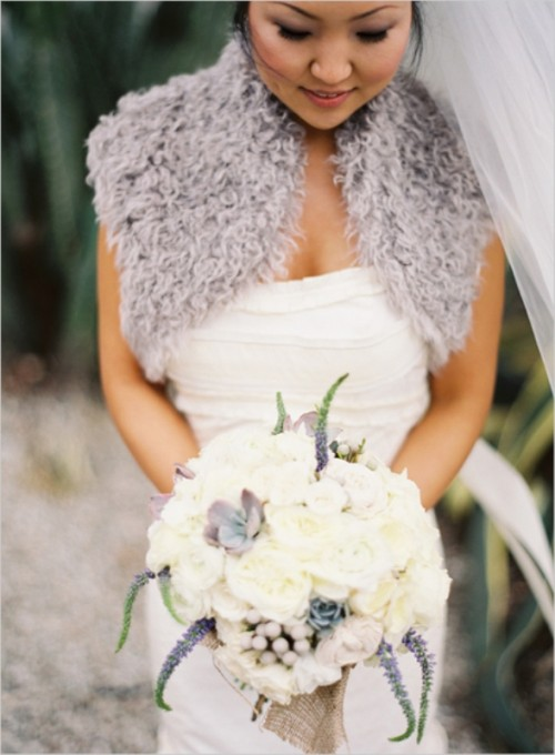 a grey faux fur coverup and grey succulents and foliage to accent a neutral bridal look