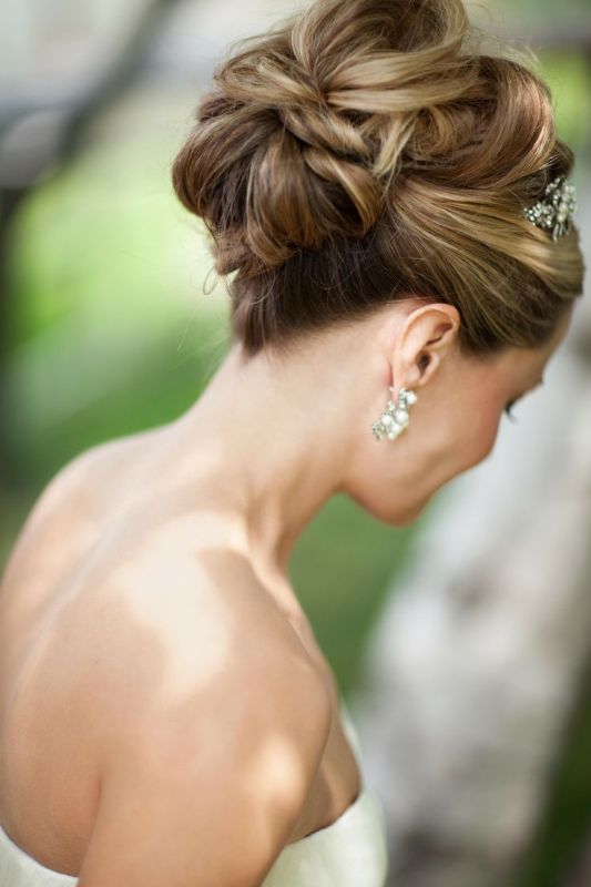 a chic twisted wedding updo with twists even on top and a shiny embellished hairpiece for a vintage or just formal bridal look