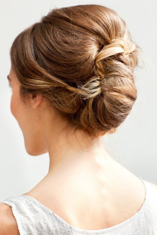 a chic twisted and a bit wavy ipdo with some volume on top is a stylsh idea for many bridal looks