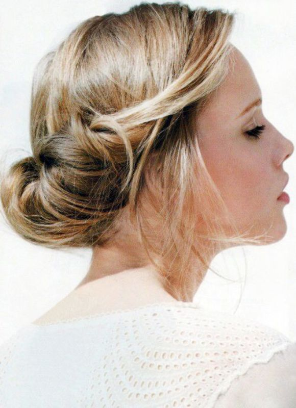 a twisted low updo with some volume on top, some hair down is a relaxed and informal idea for a bride