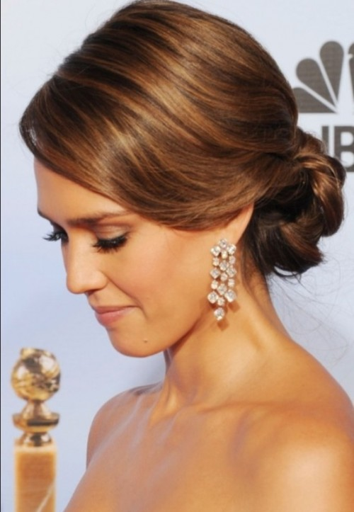 a chic wavy low braided bun with a sleek and shiny top is a timeless idea to rock at a wedding