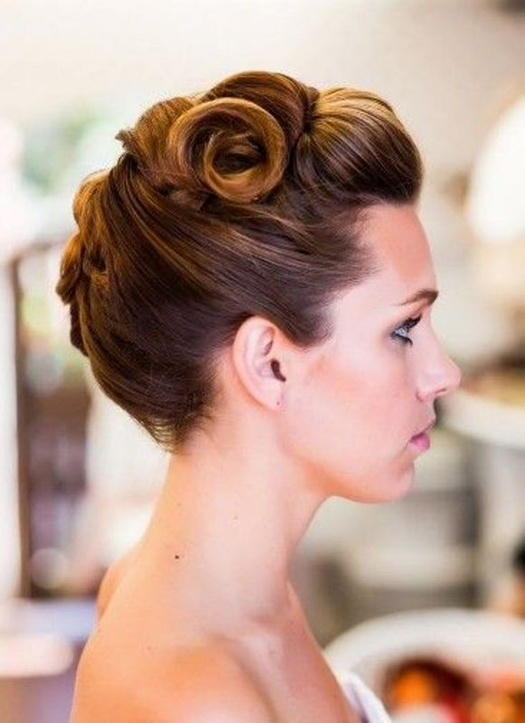 a unique wavy updo with all the hair interwoven and attached mostly on top is a very cool looking option