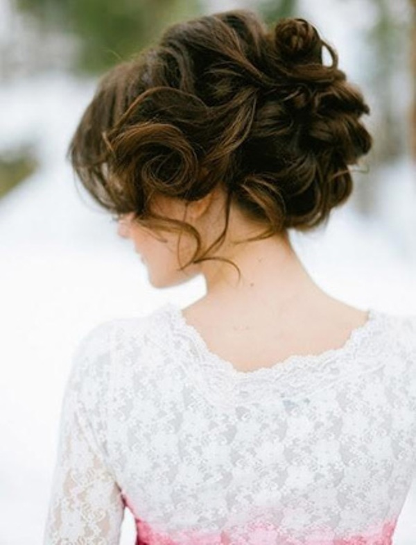 a wavy updo with some curls down and a messy voluminous top is a lovely solution for a romantic bride