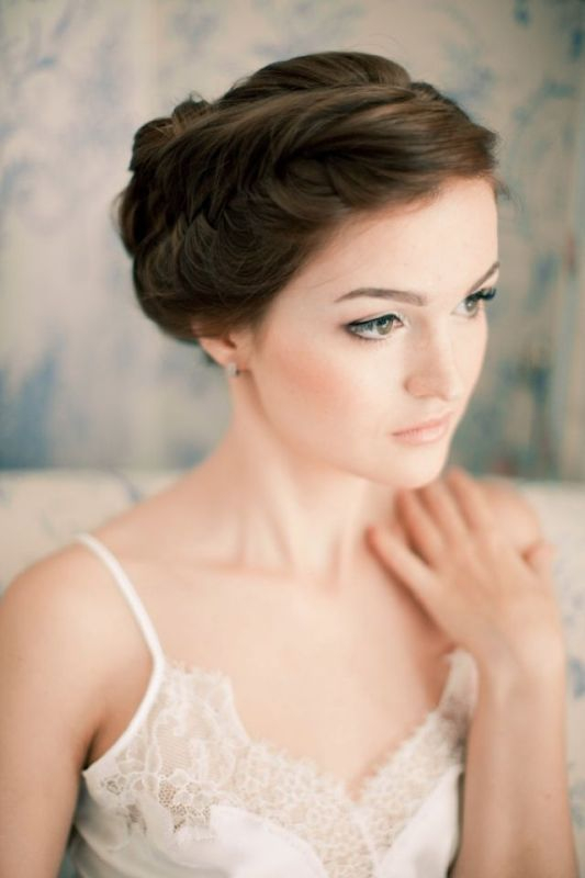 a braided  side updo with a voluminous top is a chic and cool idea for a modern bride who loves unique looks