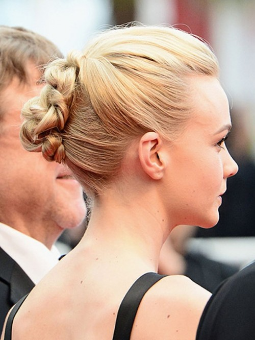 a braided updo with a volume on top is a stylish idea with a modern twist, rock it with many looks