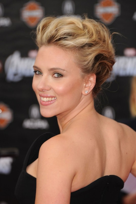 a messy and wavy updo is a chic and stylish idea for a bride with short or medium length hair and it looks very refined