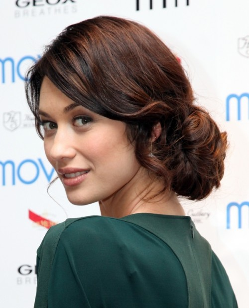 a low messy and wavy bun is a timeless and chic idea that always works and looks amazing with many bridal styles