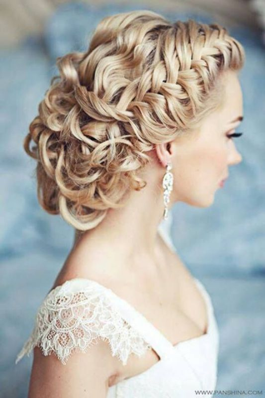 a wavy and braided low updo with braids on both sides is a fabulous idea to go for and it looks fantastic