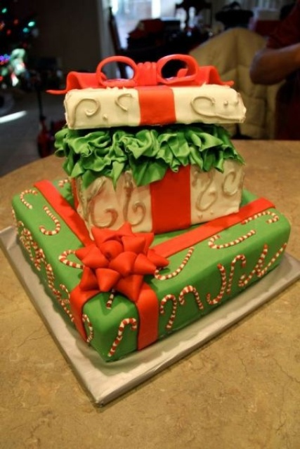 a quirky green, red and white Christmas wedding cake composed of gift boxes, with ribbons bows and patterns is a beautiful piece