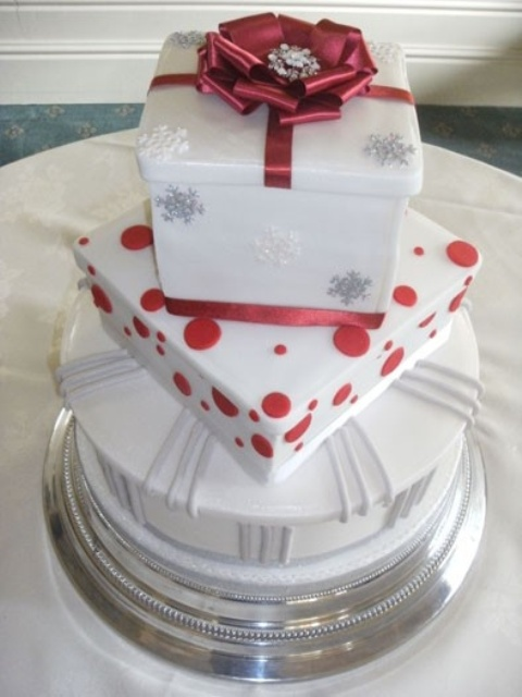 a white, silver and red Christmas wedding cake composed of gift boxes of various looks is a unique idea to rock