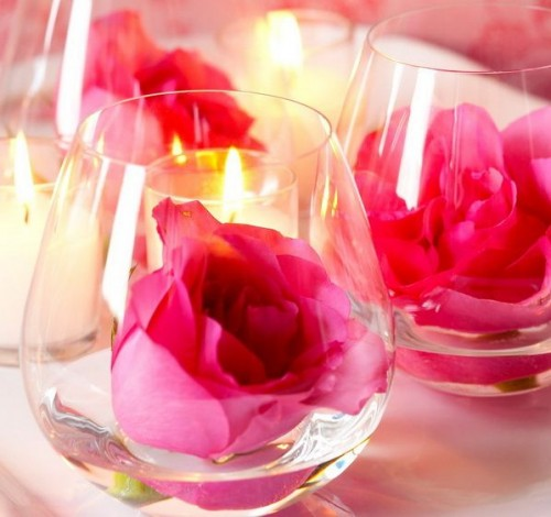 wine glasses with floating bold pink roses are lovely for stylish wedding decor and can be used anywhere