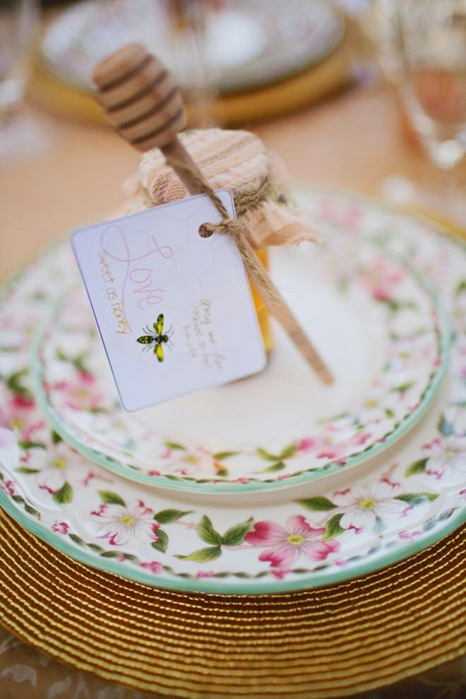 mini honey jars with wooden spoons and cool greeting cards for a spring wedding