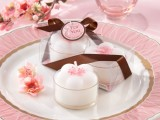 pink and white cherry blossom candles are a nice idea for a wedding and it screams spring