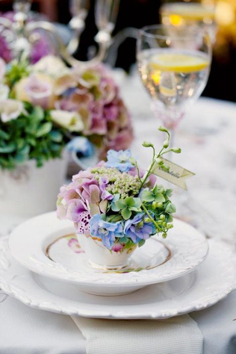 teacups with bright spring blooms are amazing for a cozy spring wedding and they feel fresh and cool
