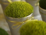 moss in pots with bows is a cool idea to refresh your wedding decor and remind that spring is on