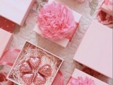 pretty boxes with pink heart-shaped candies and large pink flowers are amazing