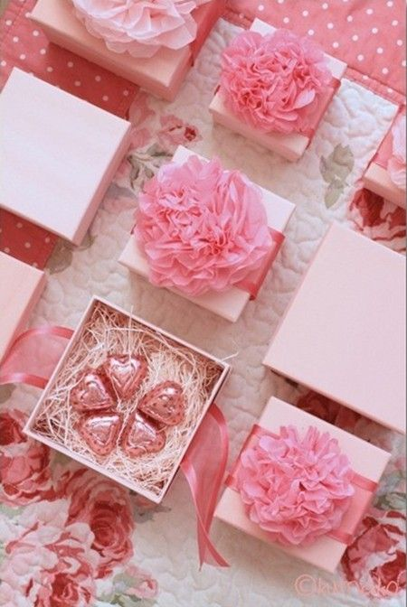 pretty boxes with pink heart shaped candies and large pink flowers are amazing