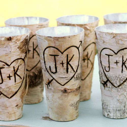 birch bark wrapped glasses or vases are great for spring woodland weddings