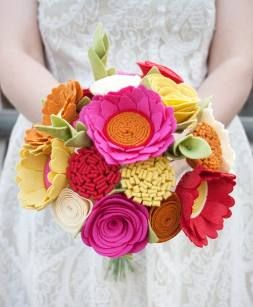 a colorful wedding bouquet of pink, yellow and red fabric blooms and ligth green fabric leaves is a funny and creative idea
