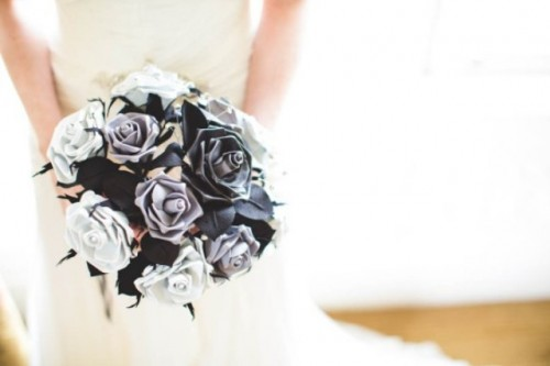 a black and white paper rose wedding bouquet is a bold and contrasting idea for a bride