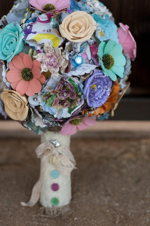 a colorful plastic flower wedding bouquet with buttons and rhinestones, with a lace wrap is a fun and bright idea to rock