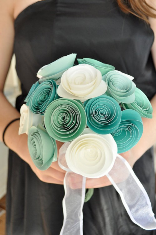 a bold ribbon wedding bouquet with turquoise and white flowers and sheer ribbons is a very creative and cool wedding bouquet