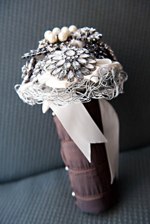 a refined neutral rhinestone and pearl brooch wedding bouquet with some wire, with a fabric wrap and ribbons is a lovely idea