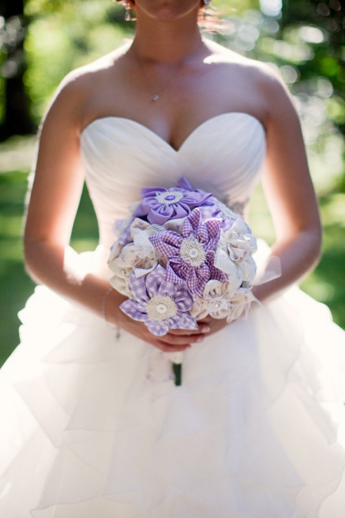 a pretty purple plaid and white fabric flower wedding bouquet with buttons and burlap is a fun idea for a summer bride