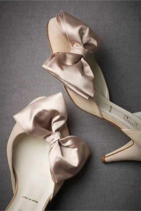 tan shoes with champagne colored silk bows that add chic and romance to them