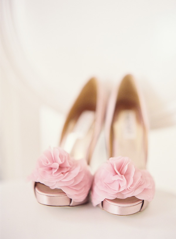 light pink peep toe wedding shoes with large fabric blooms on top are a chic touch of girlish color to your spring look