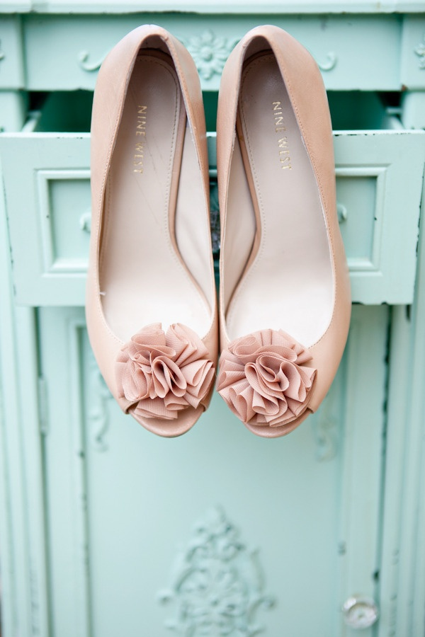 tan wedding shoes with matching fabric blooms and peep toes are stylish and will match many bridal looks