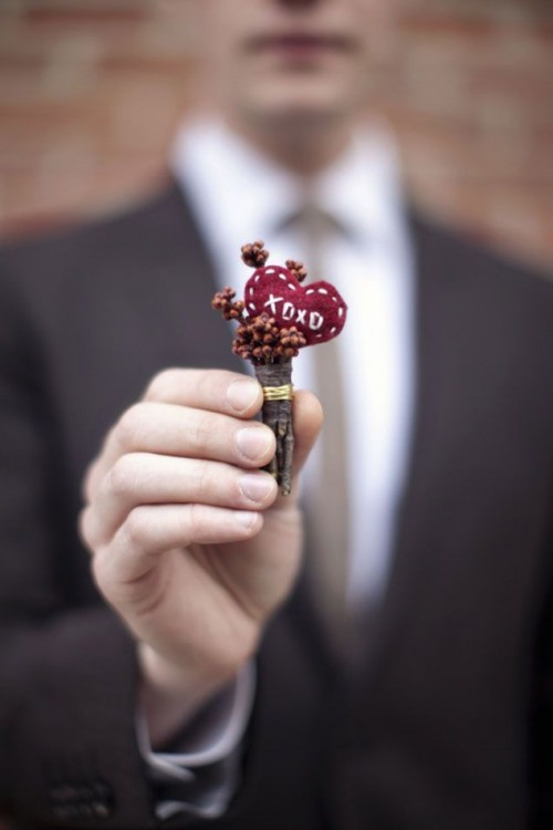 sticks, berries and a red embroidered heart for a simple and non-floral winter wedding boutonniere