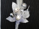 a sparkling silver/white wedding boutonniere composed of white beads, sparkling leaves imitates a floral piece