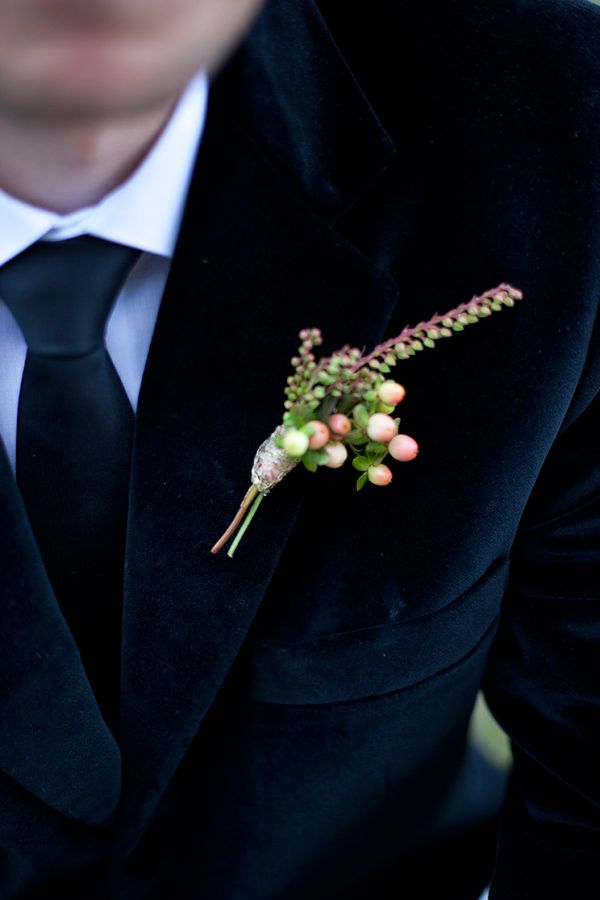 a winter boutonniere of berries and small flowers is a simple and cute all accessory to try