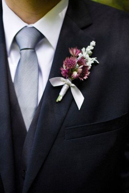 a wedding boutonniere with purple blooms and pale herbs, a neutral wrap is a stylish and bright accessory to rock
