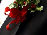 a lush Christmas boutonniere of red berries, leaves and a red ribbon bow is a bold and cool accessory to try