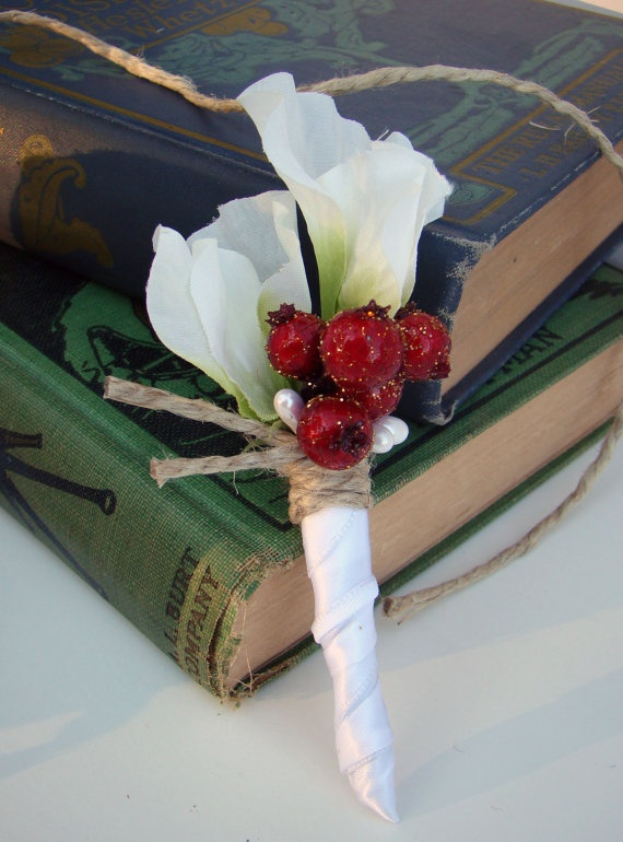 a white flower boutonniere with red berries and twine is a stylish accessory to go for and it's easy to make