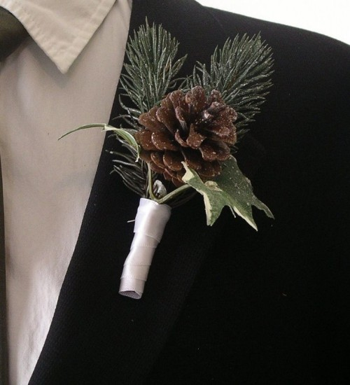 a sparkling winter boutonniere of leaves, a pinecone and fir with ribbon wrapping is a cute and chic accessory to rock