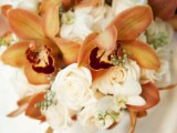 a lush fall wedding bouquet of white roses and amber lilies is a stylish and refined idea for a fall bride