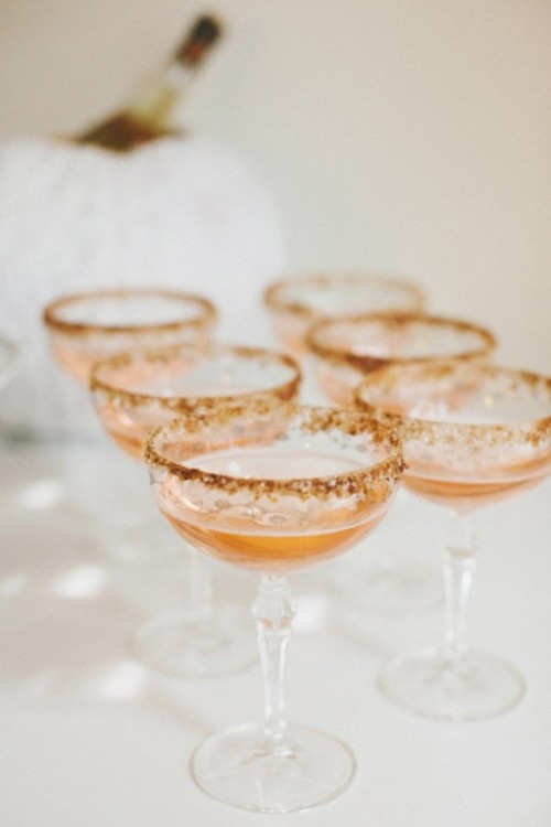 amber cocktails in glasses with a gold leaf edge are perfect signature drinks for a fall wedding