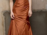 a copper strapless draped mermaid bridesmaid dress is a chic and bold idea to rock at a fall wedding
