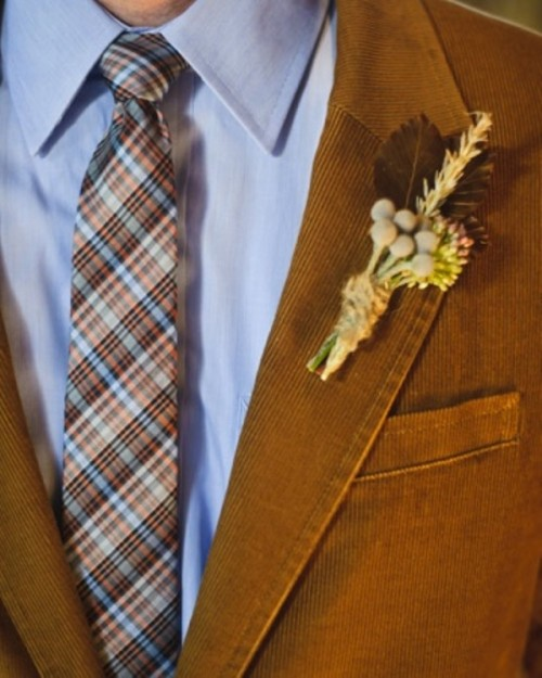 a rust colored velvet blazer and a bright plaid tie for a stylish fall groom look