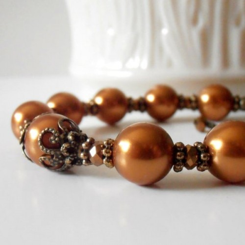 a copper bracelet of beads and rhinestones is a stylish idea for a romantic fall bride or bridesmaid
