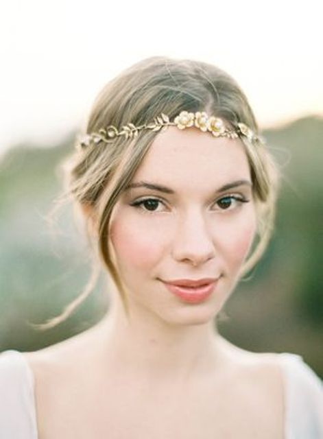 a gold flower and leaf headpiece is a free spirited boho chic idea for a spring or summer boho bride
