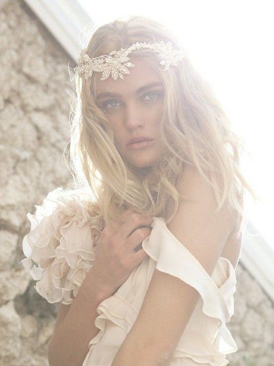 a lace and pearl floral headpiece is a cool boho chic idea for a glam boho bride